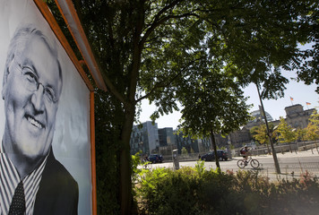 German Foreign Minister and SPD candidate for chancellor in upcoming general election, Steinmeier, is seen on election poster in Berlin