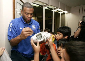 Brazil's player Julio Baptista signs autographs at his hotel in Maracaibo