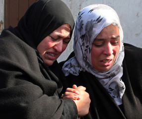 Egyptian women react to the loss of relatives in the ferry accident at the Red Sea port of Safaga, Egypt