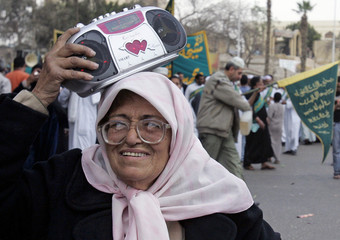 Egyptian Sufi Muslims march to celebrate the Prophet Mohammed's birthday in Cairo