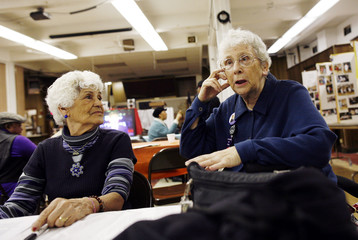 Roberts, 82, and Falcon, 77, sit at the Canaan Senior Service Center in New York