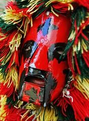 """Masked carnival reveller """"Careto"""" looks true his mask during the festivities."""