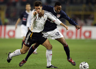 Germany's Kehl fights for the ball with Gibbs of the US during a friendly soccer match in Dortmund