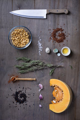Wooden kitchen table background with healthy cooking ingredients flat lay.