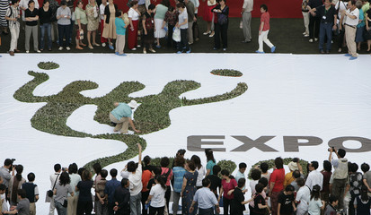 """People use """"zongzi"""", a traditional Chinese dish made from rice wrapped in bamboo leaves, to create the logo of 2010 Shanghai World Expo in Shanghai"""