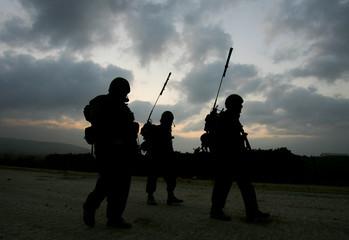 Israeli soldiers patrol near the Israeli-Lebanese border