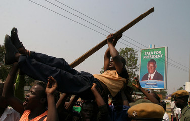 Supporters of opposition leader Sata protest outside the Electoral Commission of Zambia Election Result Centre in Lusaka