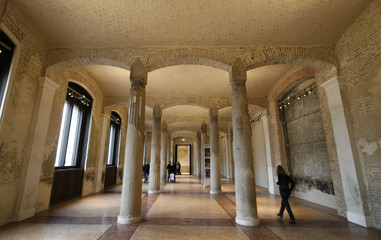 A journalist visits a hall of the 'Neues Museum' building on Museum Island in Berlin