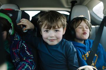 Three children riding in car