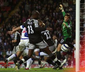 Chelsea's Cudicini watches goal scored by Blackburn Rovers' Reid during English Premier League match in Blackburn