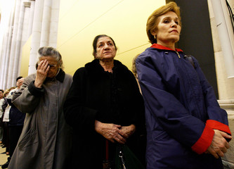 Worshippers pray for Pope John Paul II during special mass inside Almudena Cathedral in Madrid.