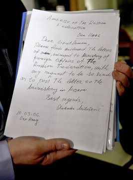 A handwritten letter by former Yugoslav president Milosevic is displayed in The Hague