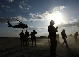 A U.S. helicopter lands at a military base in Ghazni province