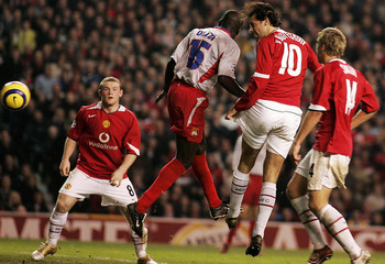 Manchester United's Van Nistelrooy scores against Olympique Lyon in their Champions League match at Old ...