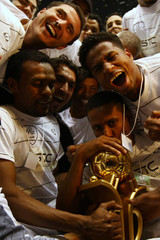 Al Shabab's players pose with the Saudi Prince Faisal Bin Fahad Cup after their victory over Al Nasr in the final soccer match in Riyadh