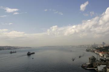 Vessels cruise through Bosphorus waterways past the mosque of Ortakoy in Istanbul
