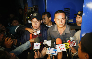 Juan Garcia answers questions after being released as a hostage in Cuilapa