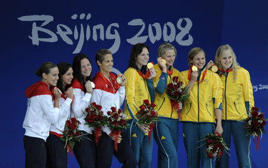 U.S. team poses with Australian team after women's 4x100m medley relay swimming final at the Beijing 2008 Olympic Games