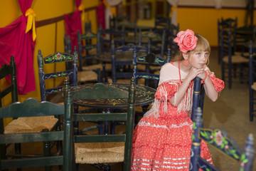 Little girls in flamenco style dress at the Sevilla, Spain. Seville's April Fair on April