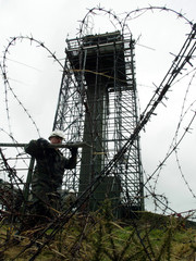 A British army sapper carries out demolition work on the Romeo 14 observation post on Cloghoge Mount..