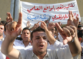 Students rally outside the college they attend in Basra