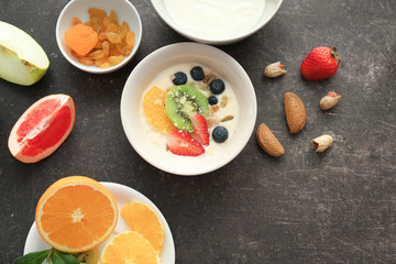 Composition with tasty yogurt and different products on table