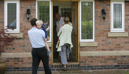 Kate McCann and her husband Gerry, parents of the missing girl Madeleine McCann, arrive home in Rothley