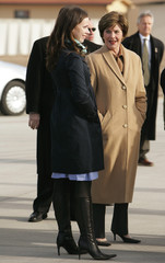 US first lady Laura Bush talks to her daughter Barbara on tarmac at Aviano Air Base