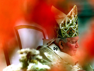 Pope John Paul II concentrates during the Easter ceremony in St. Peter's Square April 23. [The 79-ye..