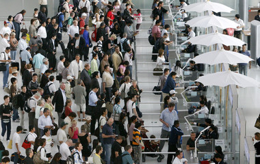Passengers clear immigration before heading to their gate at Bangkok's Suvarnabhumi Airport