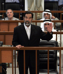 Former Iraqi President Saddam speaks during his trial in Baghdad