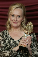 "Martine Chevallier poses with her award during the French theatre award ceremony ""Les Molieres"" in Paris"