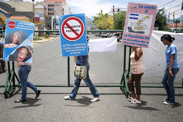 Activists from the the gay, lesbian, bisexual and transgender (GLBT) movements protest against homophobia outside the Presidential House in Tegucigalpa