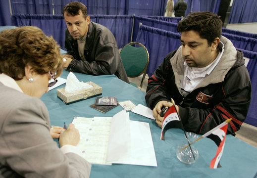 Iraqi citizens register to vote near Chicago for the forthcoming Iraqi elections.