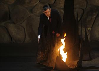 Britain's PM Brown rekindles eternal flame at Holocaust memorial in Jerusalem