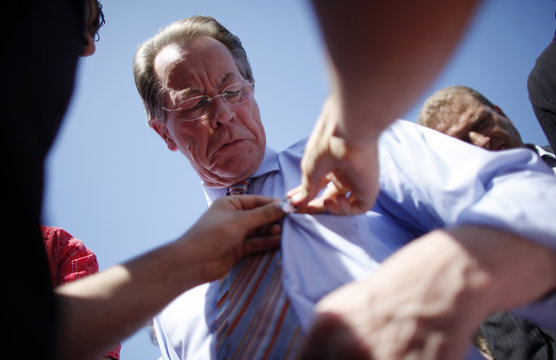 German Social Democratic leader Muentefering gets a sticker on his shirt during election campaign rally in Heusweiler