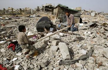 Palestinian boys play in Jabalya