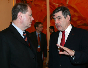 Britains's Chancellor of the Exchequer Brown talks to his counterpart from Germany Steinbrueck prior to an ECOFIN meeting in Vienna