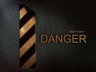 Black and yellow stripes sticker sign on dark background with danger keep away word