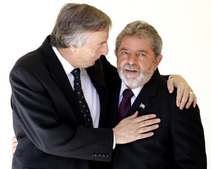 Argentine President Kirchner and counterpart Brazilian Lula da Silva during Mercosur summit in Brazil.