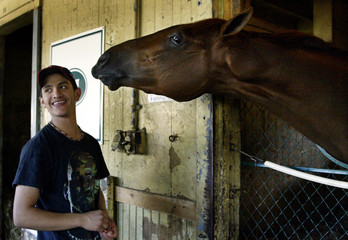 KENTUCKY DERBY WINNER FUNNY CIDE WITH GROOM AT BELMONT PARK.