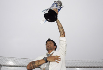 Porto's Lucho holds up Portuguese Cup after final against Pacos Ferreira in Lisbon