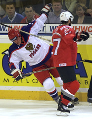 RUSSIA'S KARPOV IS PUSHED BY CANADA'S PECA DURING ICE HOCKEY WORLD CHAMPIONSHIP MATCH AGAINST ...