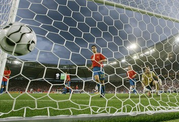 Spain's players look at ball after goal by Tunisia's Joahar Mnari during Group H World Cup 2006 soccer match in Stuttgart