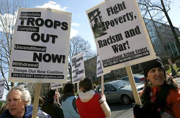 Anti-war demonstrators rally in front of British embassy in Washington during third anniversary of Iraq invasion