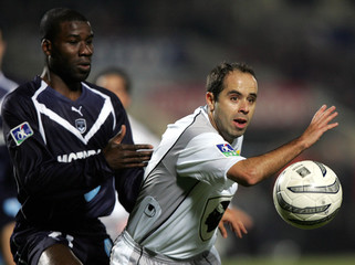 Bordeaux's striker Afanou tussles with Bastia's defender Ziani in Bordeaux during French League ...