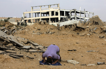 Palestinian labourer prays in Northern Gaza Strip