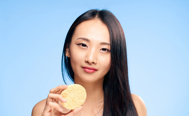 woman with sponge, smile, clean skin