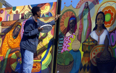 SISAY SHIMELES FROM ETHIOPIA GIVES FINAL TOUCH TO HIS PAINTING IN HANOVER.