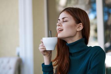 happy woman enjoying breakfast in the morning, mug of tea